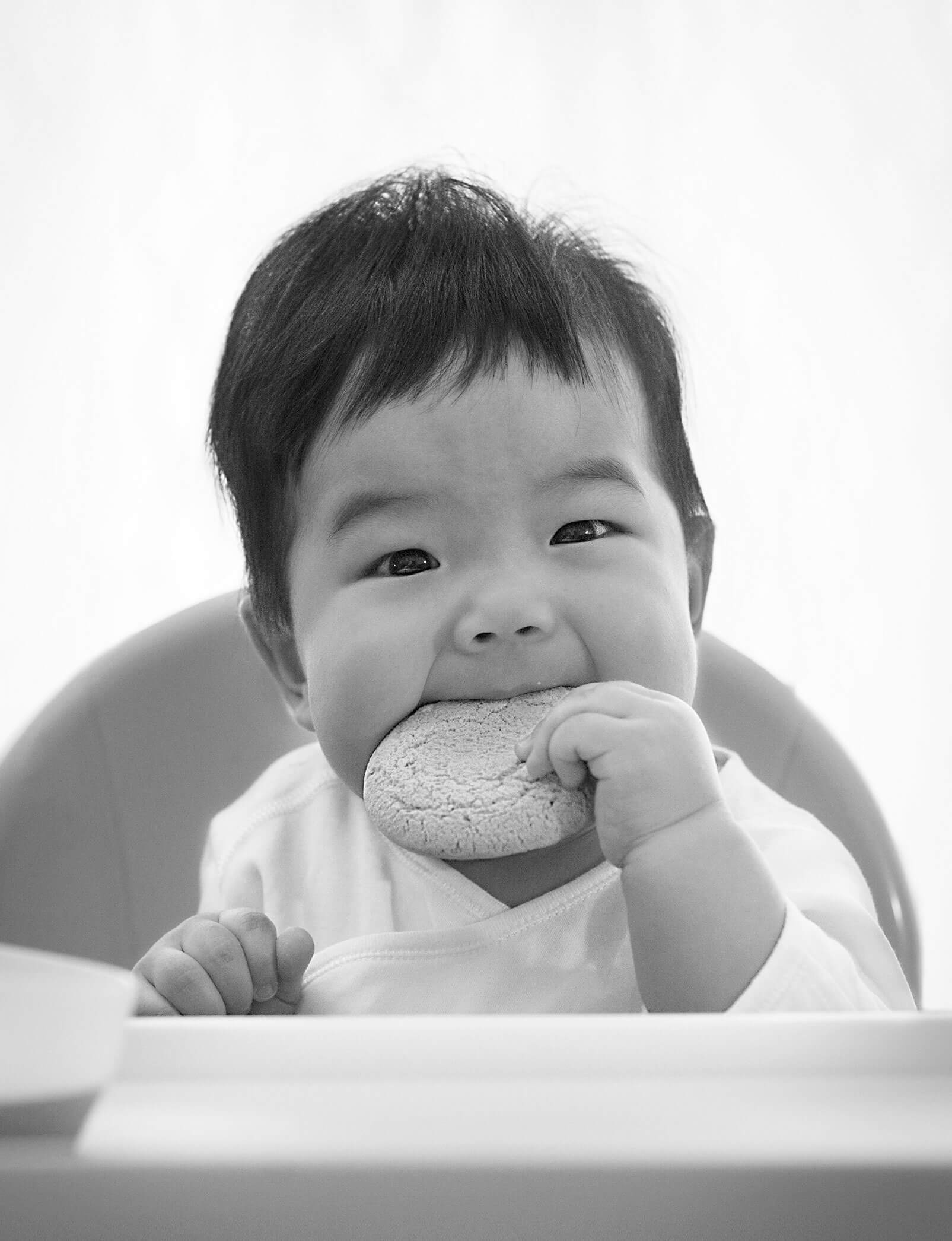 Baby eating biscuit