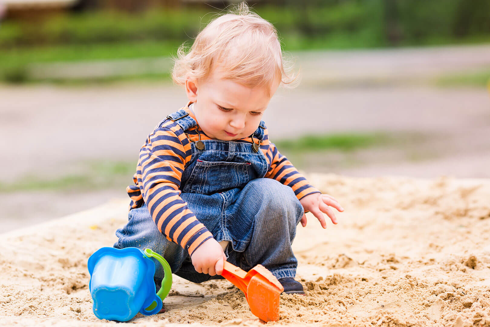 Baby playing in sandpit